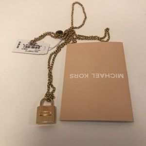 Brand new Michael Kors Ridged Padlock Necklace